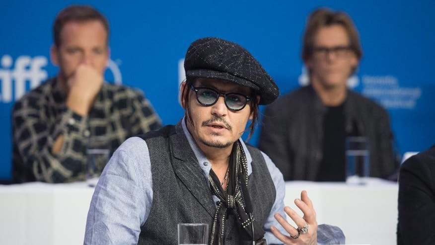 "Actor Johnny Depp appears at a press conference promoting the film ""Black Mass"" during the 2015 Toronto International Film Festival in Toronto on Monday, Sept. 14, 2015. (Darren Calabrese/The Canadian Press via AP)"