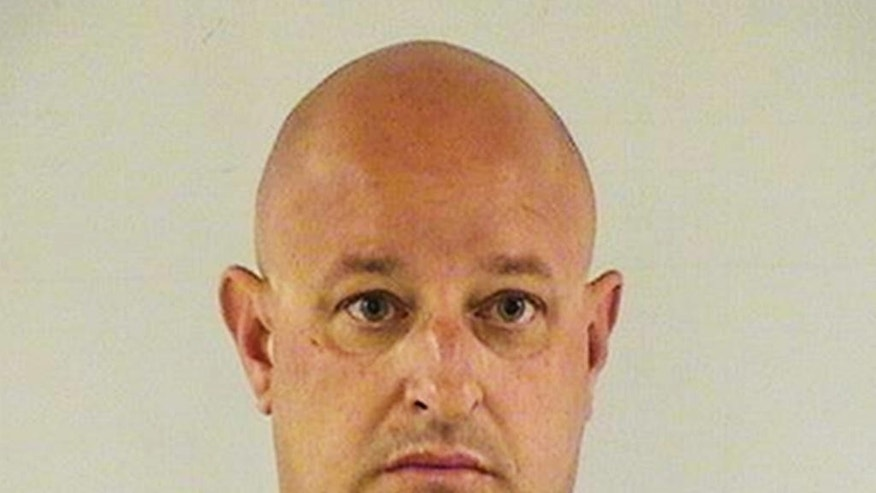 This undated photo provided by the Lake County Sheriff's Office shows Joseph A. Battaglia, a retired Chicago police officer who was arrested and charged with threatening investigators in the case of slain Fox Lake Police Lt. Charles Joseph Gliniewicz. Battaglia is scheduled to appear in court Tuesday, Sept. 15, 2015, in Waukegan, Ill., where a judge is expected to ask Battaglia if he's hired an attorney. At an initial hearing, he was told he doesn't qualify for a public defender. (Lake County Sheriff's Office via AP)
