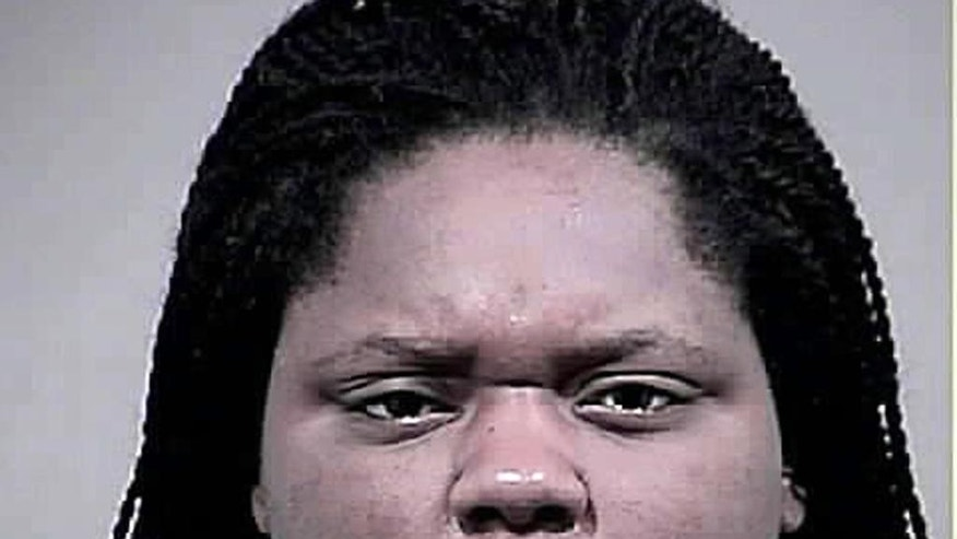 This photo provided by the Charles County, Md. Sheriff's Office shows Romechia Simms. Simms, who was found pushing her dead son in a playground swing earlier this year, has been indicted and charged with manslaughter and child abuse, authorities announced Monday, Sept. 14, 2015. (Charles County, Md. Sheriff's Office via AP)