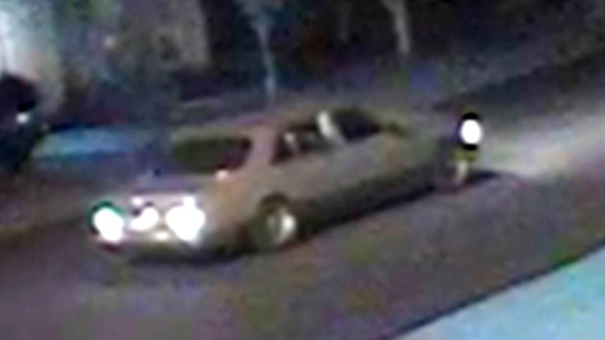 This May 13, 2015 surveillance photo released by the Carson City Sheriff's Office that detectives are releasing for help in identifying a potential suspect and potential suspect vehicle spotted near the home of Carson City Justice of the Peace John Tatro, where an incendiary device was found that day. The burning object is one of a series of threatening incidents targeting Tatro in the past few years, including gunfire through his front door and an ominous Christmas card. (Carson City Sheriff via AP)
