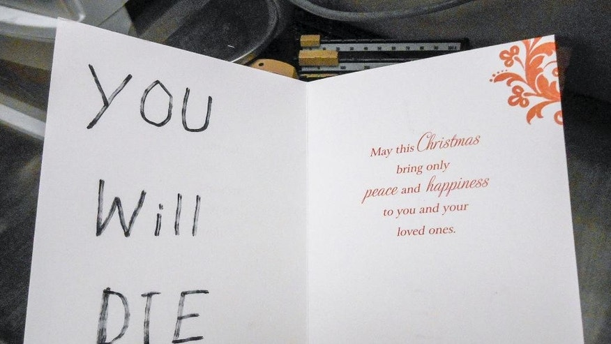 "This undated photo provided by the Carson City Sheriff's Office shows a Christmas card sent in December 2014 to Carson City Justice of the Peace John Tatro. Someone left Tatro the ominous Christmas card with the words ""YOU WILL DIE"" in big block letters and an incendiary device that fizzled out in front of his house before causing any damage. Even though officials have combed Tatro's past court decisions for evidence of a vendetta, offered $5,000 in reward money and released surveillance footage with a glimpse of a possible suspect, detectives are stumped. (Carson City Sheriff via AP)"