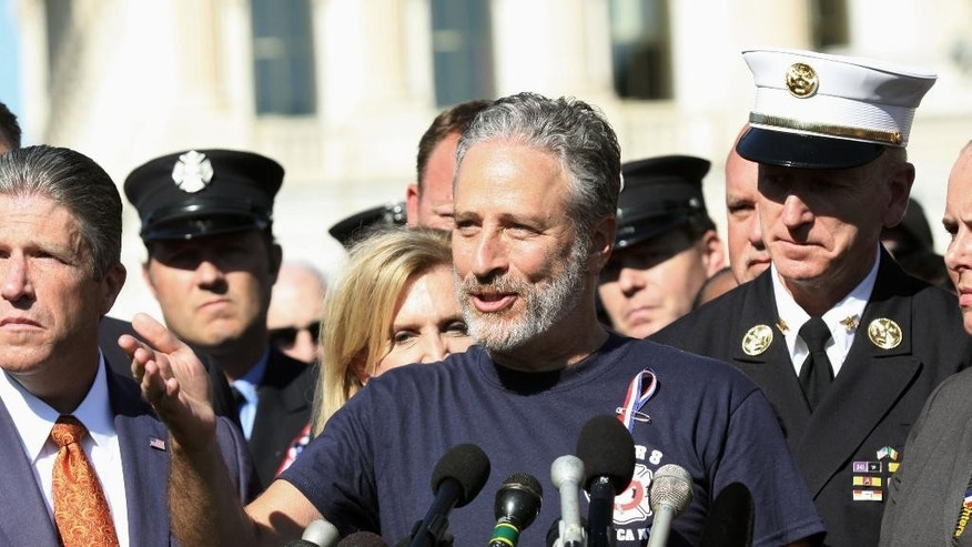 Comedian Jon Stewart stands with New York City first responders and speaks during a rally on Capitol Hill in Washington, Wednesday, September 16, 2015, calling for the extension of the the Zadroga Heath & Compensation Act that provides health care and compensation to 9/11 first responders and victims will come to an end if not renewed by Congress.  (AP Photo/Lauren Victoria Burke)
