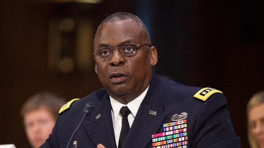 "US Central Command Commander Gen. Lloyd Austin III, testifies on Capitol Hill in Washington, Wednesday, Sept. 16, 2015, before the Senate Armed Services Committee hearing on 'US military operations to counter the Islamic State in Iraq. Austin vowed to take ""appropriate action"" if an investigation indicates that senior defense officials altered intelligence reports on the Islamic State and other militant groups in Syria to exaggerate progress being made against the terrorist groups.   (AP Photo/Pablo Martinez Monsivais)"