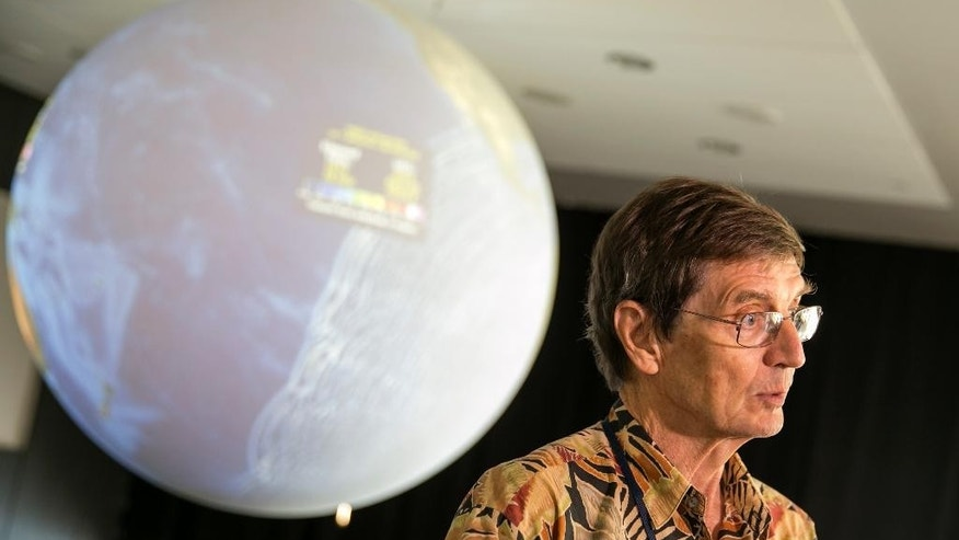 CORRECTS FROM TSUNAMI WARNING TO TSUNAMI WATCH -Geophysicist Dr. Gerard J. Fryer, announces the tsunami watch for Hawaii has changed to a tsunami advisory at the Pacific Tsunami Warning Center on Ford Island at Joint Base Pearl Harbor-Hickam Hawaii, Wednesday, Sept. 16, 2015, in Honolulu.  A powerful magnitude-8.3 earthquake hit off Chile's northern coast Wednesday night putting Hawaii under a tsunami watch.  (AP Photo/Marco Garcia)