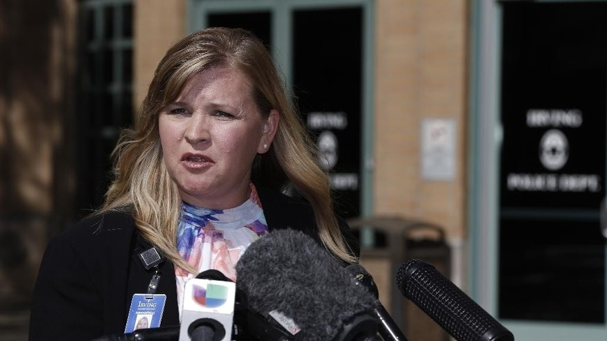 Irving ISD Director of Communications Lesley Weaver delivers a statement regarding Ahmed Mohamed, a high school student detained by police on Monday, during a news conference, Wednesday, Sept. 16, 2015, in Irving, Texas.  Police detained the 14-year-old Muslim boy after a teacher at MacArthur High School decided that a homemade clock he brought to class looked like a bomb, according to school and police officials. The family of Ahmed Mohamed said the boy was suspended for three days from the school in the Dallas suburb.  (AP Photo/Brandon Wade)