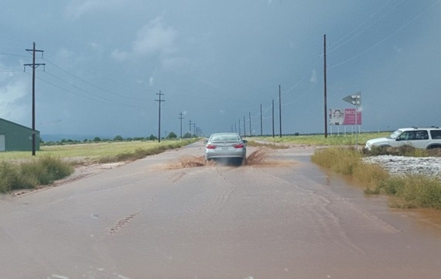 Sept. 14, 2015: This photo shows flooding on U.S. Highway 89 in Hildale, Utah. State officials said seven people were killed and six others missing when two cars were washed away by a flash flood Monday. (Courtesy Tabitha Corry)