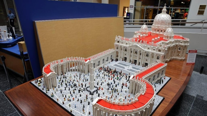 In this Friday, Sept. 11, 2015 photo, shown is a Lego representation of the St. Peter's basilica and square, at The Franklin Institute in Philadelphia. The Rev. Bob Simon spent about 10 months building it with approximately half-a-million Legos. (AP Photo/Matt Rourke)