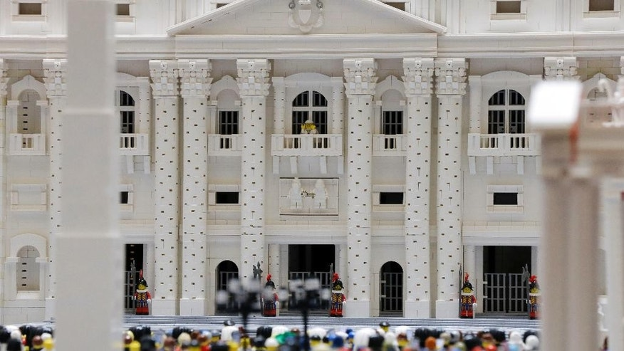 In this Friday, Sept. 11, 2015 photo, shown a Lego pope figure on a balcony overlooking the crowd in the piazza in a Lego representation of the St. Peter's basilica and square, at The Franklin Institute in Philadelphia. The Rev. Bob Simon spent about 10 months building it with approximately half-a-million Legos. (AP Photo/Matt Rourke)