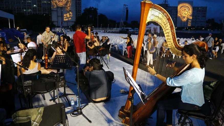 Members of the Havana University of the Arts Orchestra rehearse ahead of Pope Francis' Mass at Revolution Square, in Havana, Cuba, Wednesday, Sept. 16, 2015. Pope Francis will visit Cuba from Sept. 19-22, before arriving in the United States, making him the third pontiff to visit the island nation. (AP Photo/Desmond Boylan)
