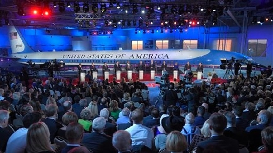 The candidates stand behind their podiums during the CNN Republican presidential debate at the Ronald Reagan Presidential Library and Museum on Wednesday, Sept. 16, 2015, in Simi Valley, Calif. (AP Photo/Mark J. Terrill)
