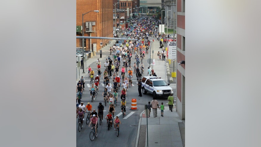 In a photo from Aug. 31, 2015, cyclists ride in the Greektown area in Detroit. Move aside Motor City. Make way for a new export that is turning Detroit's auto legacy on its wheels. Thousands of bicyclists hit the streets Monday evenings from spring to fall for Slow Roll Detroit, an ultracasual 10 mile or so tour of its best and blighted neighborhoods at speeds up to 10 mph. (AP Photo/Carlos Osorio)