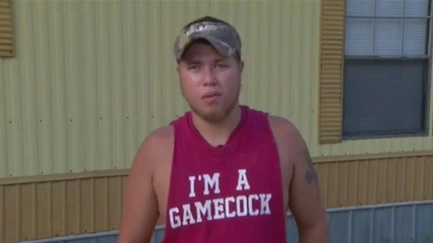 In this June 18, 2015 frame from video Joey Meek, friend of Dylann Roof who is accused of killing nine black church members during Bible study on June 17 in Charleston , S.C., speaks to The Associated Press. Meek was arrested Thursday, Sept. 17, more than a month after authorities told him he was under federal investigation for lying to them and failing to report a crime, an official close to the probe said. (APTN via AP)
