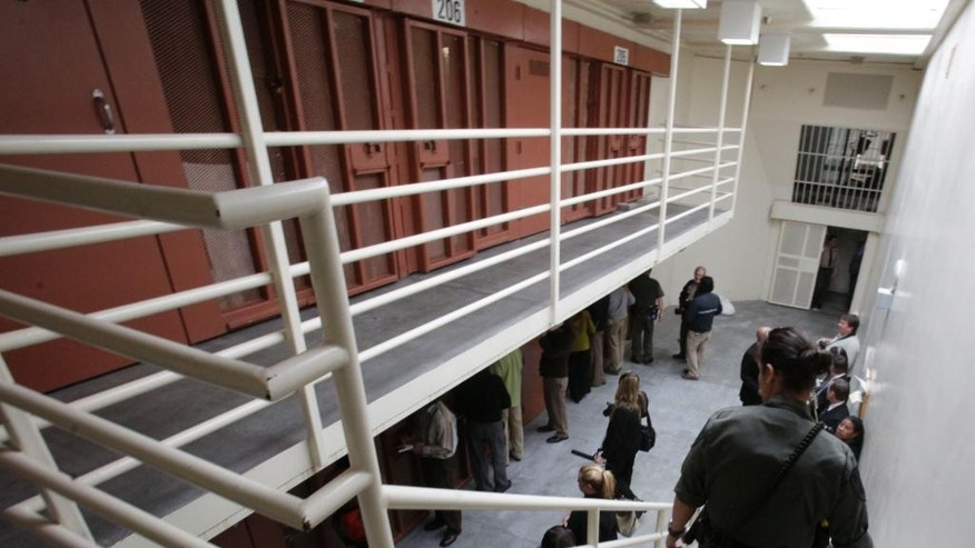 FILE -- In this Aug. 17, 2011 file photo, reporters inspect one of the two-tiered cell pods in the Security Housing Unit at the Pelican Bay State Prison near Crescent City, Calif. Inmates say newly imposed welfare checks in the SHU have created excessive noise by the guards, causing California prison officials to hand out earplugs to inmates and tell the guards to walk softly while going about their rounds.(AP Photo/Rich Pedroncelli, file)