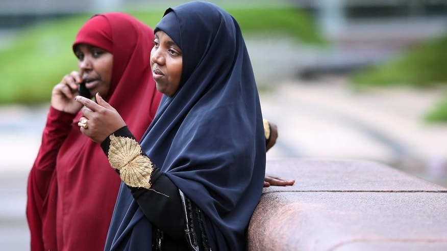 Ayan Abdurahman right, waits for a ride after attending a hearing for her son Zacharia Abdurahman, one of seven defendants charged with conspiring to join ISIL Thursday, Sept. 17, 2015 in Minneapolis, Minn. Zacharia Adburahman plead guilty to one count of conspiracy to provide material support to a foreign terrorist group, specifically the Islamic State group, in federal court on Thursday. Authorities say he was part of a group of friends in Minnesota's Somali community who met secretly to plan different ways to travel to Syria. (Jerry Holt/Star Tribune via AP)