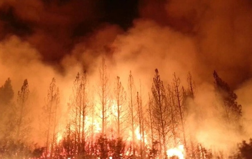 """This photo obtained August 23, 2013 courtesy of the US Forest Service, shows the Rim Fire as it burns near Yosemite National Park, California. The wildfire outside Yosemite National Park,  is one of more than 50 major brush blazes burning across the western United States , has more than tripled in size overnight and still threatens about 2,500 homes, hotels and camp buildings. Fire officials say that the blaze burning in remote, steep terrain has grown to more than 84 square miles (135 km) and was only 2 percent contained on August 22, 2013, down from 5 percent a day earlier. AFP PHOTO / US FOREST SERVICE == RESTRICTED TO EDITORIAL USE / MANDATORY CREDIT: """"AFP PHOTO / US FOREST SERVICE / NO MARKETING / NO ADVERTISING CAMPAIGNS / DISTRIBUTED AS A SERVICE TO CLIENTS ==HO/AFP/Getty Images"""