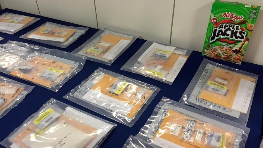 Packages of heroin fill a table during a news conference at the Brooklyn District Attorney's Office in New York, Thursday, Sept. 17, 2015. A family-run heroin ring brought in more than $1.5 million in 2014 by using cereal boxes to conceal the drugs, which were sold to distributors including a court employee and a drug counselor, a district attorney said Thursday in announcing the arrests of two dozen people. (AP Photo/Michael Balsamo)