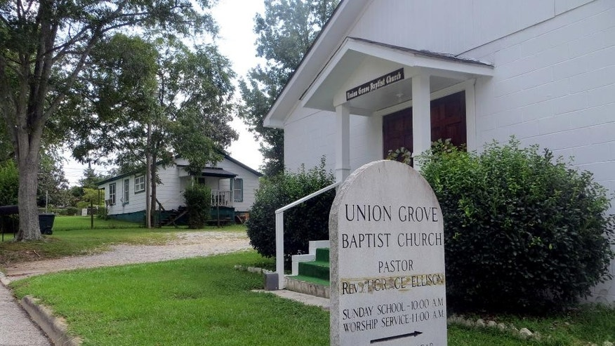 This photo taken Wednesday, Sept. 16, 2015, shows the exterior of Union Grove Baptist Church in Elberton, Ga. The church has removed 103-year-old Genora H. Biggs as a member for displaying what a church statement said was conduct detrimental to the congregation. (Wayne Ford/Athens Banner-Herald via AP) MAGS OUT; MANDATORY CREDIT