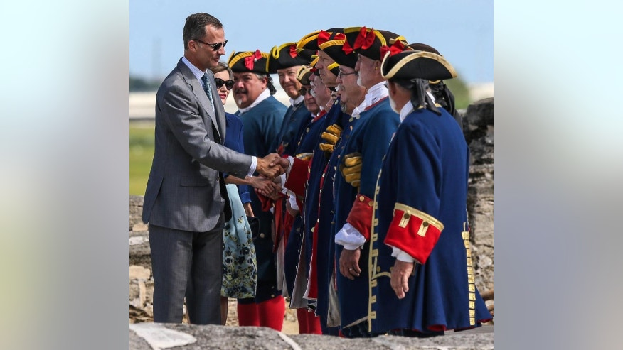King Felipe VI and Queen Letizia of Spain greet period actors at the Castillo de San Marcos during St. Augustine's 450th Commemoration, Friday, Sept. 18, 2015, St. Augustine, Fla. (AP Photo/Gary McCullough)