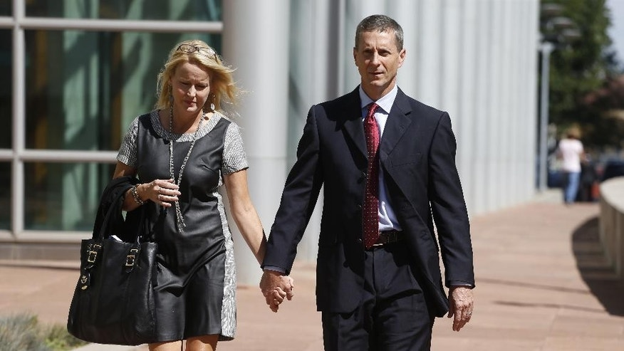 Barry Bertolet, right, the brother of Toni Henthorn, walks with his wife Paula from a federal courthouse following closing arguments in the murder trial of Harold Henthorn, charged with killing his second wife, Toni Henthorn, on a hike they took to celebrate their 12th wedding anniversary in 2012, in Denver, Friday, Sept. 18, 2015. (AP Photo/Brennan Linsley)