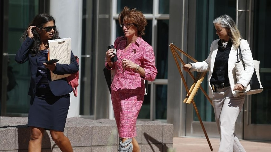 Members of the prosecution team, left to right, Assistant U.S. Attorney Suneeta Hazra, Assistant U.S. Attorney Valeria Spencer, and Beth Shott, a special agent with the National Parks Service, walk from a federal courthouse in Denver, Friday, Sept. 18, 2015, following closing arguments in the murder trial of Harold Henthorn, who is charged with killing his second wife, Toni Henthorn, on a hike they took to celebrate their wedding anniversary in 2012. (AP Photo/Brennan Linsley)
