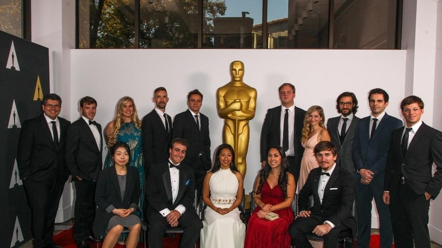 Finalists, from left, (back row) Alexandre Peralta, Bennett Lasseter, Meg Smaker, Henry Hughes, Patrick Vollrath, Dustin Loose, Emily Kassie, Ilker Çatak, Daniel Drummond, Seth Boyden, (Front row) ChiHyun Lee, Nicholas Manfredi, Alyce Tzue, Elizabeth Ku-Herrero, and Jeremy Cloe attend the 42nd Student Academy Awards Ceremony at the Samuel Goldwyn Theater on Thursday, Sept. 17, 2015 in Los Angeles. (Photo by Paul A. Hebert/Invision/AP)