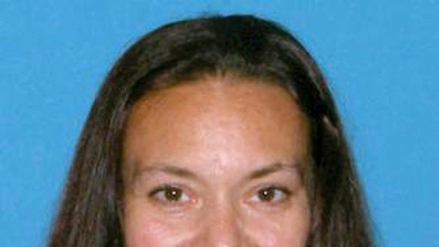 CORRECTS NAME TO RACHELLE FROM RACHEL - This undated identification photo released Friday, Sept. 18, 2015 by the Suffolk County District Attorney's Office shows Rachelle Bond, mother of Bella Bond, the toddler whose body was found in a trash bag on a Boston Harbor beach in June and who was known for months as only Baby Doe. Rachelle Bond was arrested and charged as an accessory to murder after the fact in Bella's death. Her boyfriend, Michael McCarthy, was charged with murder. (Suffolk County District Attorney's Office via AP)