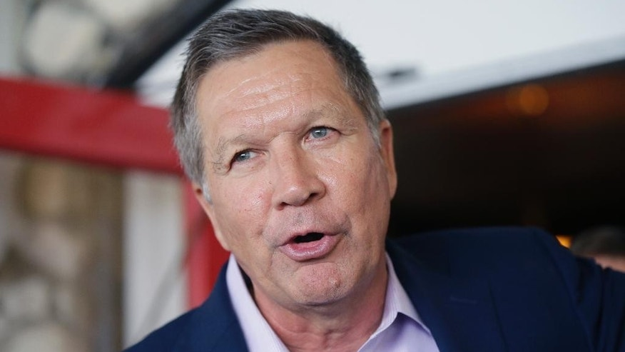Republican presidential candidate, Ohio Gov. John Kasich addresses supporters during a reception at the 2016 Mackinac Republican Leadership Conference, Saturday, Sept. 19, 2015, in Mackinac Island, Mich. (AP Photo/Carlos Osorio)