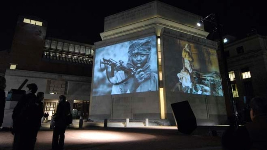 Nov. 20, 2006: Images from Darfur and Chad are projected on the exterior walls of the United States Holocaust Memorial Museum in Washington.