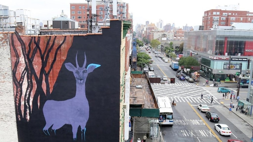 "In this Sept. 10, 2015 photo, a large gazelle mural is shown on the side of a building in the Harlem neighborhood of New York. The mural is one of about half a dozen that have been commissioned as part of a campaign to raise awareness for a nonprofit created by Maziar Bahari, the journalist who spent 118 days in an Iranian jail after an appearance on ""The Daily Show with Jon Stewart. The murals are being painted on buildings around the city as the United Nations General Assembly kicks off Tuesday, Sept. 15. Bahari hopes the art will attract the attention of diplomats and spark a conversation about human rights. (AP Photo/Mike Balsamo)"