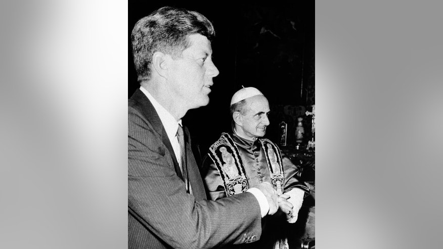 President John F. Kennedy stands with Pope Paul VI at an audience in the Vatican July 2, 1963.  Kennedy's meeting with Pope Paul VI at the Vatican was historic: the first Roman Catholic president of the United States was seeing the Roman Catholic pontiff only days after his coronation. Kennedy _ who struggled against anti-Catholic bias during his presidential campaign _ only shook hands with the pope rather than kissing his ring, as is the usual practice for Catholics.  (AP Photo)