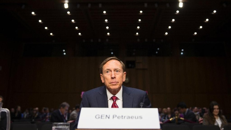 Former CIA Director David Petraeus prepares to testify on Capitol Hill in Washington, Tuesday, Sept. 22, 2015, before the Senate Armed Services Committee hearing on Middle East policy. Petraeus apologized to Congress on Tuesday for sharing classified information with his biographer and mistress, Paula Broadwell. It was his first public testimony before lawmakers since resigning as CIA director. (AP Photo/Evan Vucci)