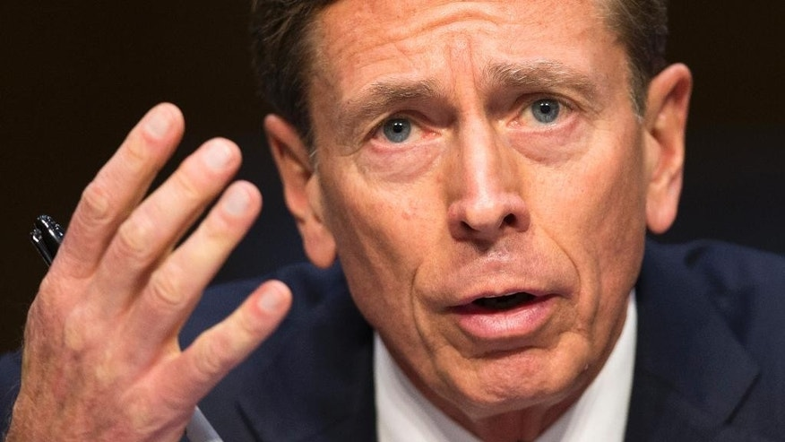 Former CIA Director David Petraeus testifies on Capitol Hill in Washington, Tuesday, Sept. 22, 2015, before the Senate Armed Services Committee hearing on Middle East policy. (AP Photo/Evan Vucci)