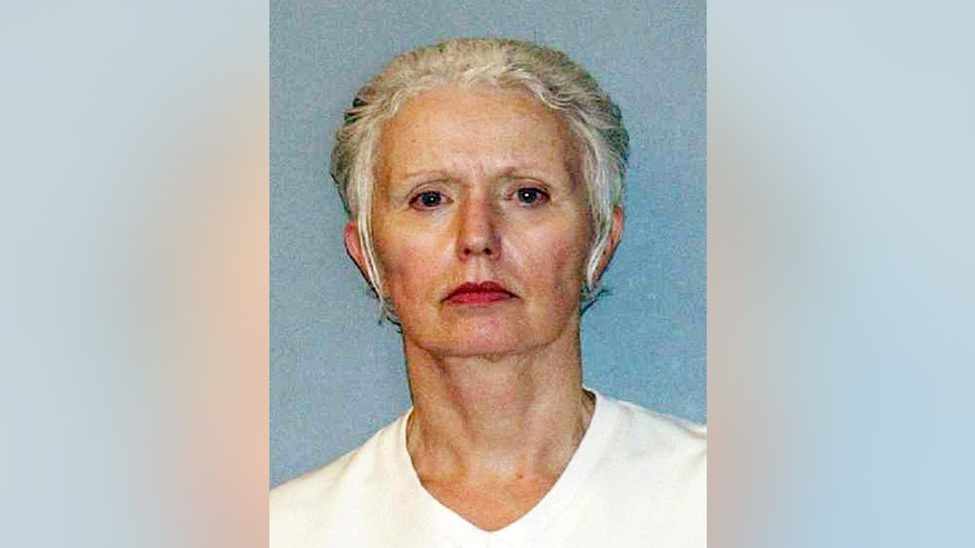 FILE - This undated file photo provided by the U.S. Marshals Service shows Catherine Greig, longtime girlfriend of Whitey Bulger, who was captured with Bulger in 2011 in Santa Monica, Calif. Greig pleaded guilty in federal court in Boston in 2012 and is serving an eight-year sentence for identity fraud and conspiracy to harbor a fugitive. Greig was indicted Tuesday, Sept. 22, 2015, on one count of criminal contempt that alleges she refused to testify since December 2014 whether other people helped Bulger during his 16 years on the run. (AP Photo/U.S. Marshals Service, File)