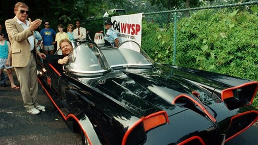 June 27, 1989: In this file photo, the original Batman, Adam West, left, stands beside the old Batmobile driven by owner Scott Chinery in Philadelphia. Batman won't have to worry about Batmobile knockoffs after a federal appeals court ruled the caped crusader's vehicle is entitled to copyright protection.