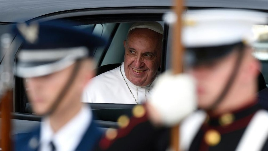 Pope Francis sits in his car, a Fiat 500, after arriving at Andrews Air Force Base, Md., Tuesday, Sept. 22, 2015. The Pope is spending three days in Washington before heading to New York and Philadelphia. This is the Pope's first visit to the United States. (AP Photo/Susan Walsh)
