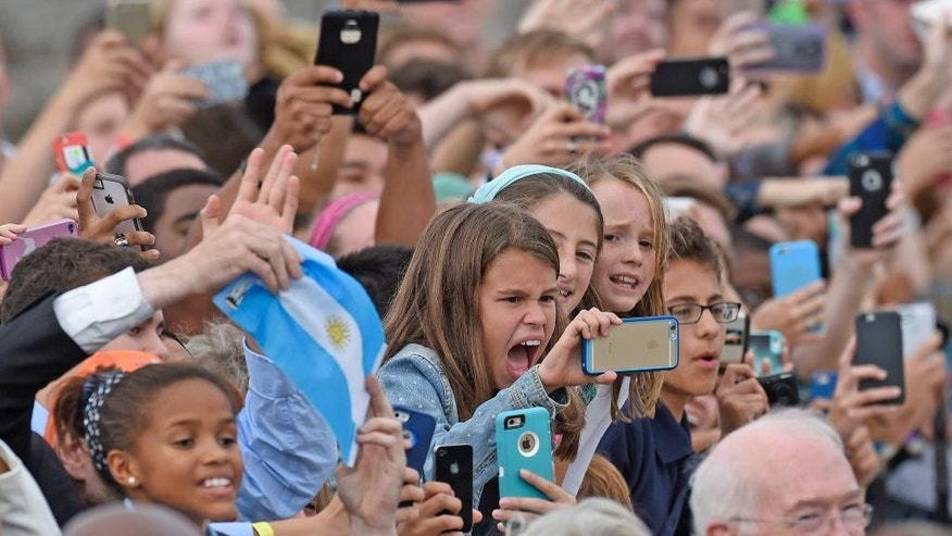 The crowd cheers as Pope Francis arrives at Andrews Air Force Base, Md., Tuesday, Sept. 22, 2015. The Pope is spending three days in Washington before heading to New York and Philadelphia. This is the Pope's first visit to the United States. (AP Photo/Susan Walsh)