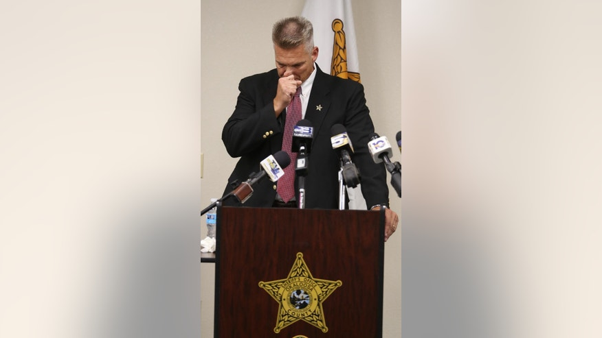 Okaloosa Sheriff Larry Ashley speaks during a news conference announcing the death of Okaloosa County Deputy Bill Myers following a shooting Tuesday, Sept. 22, 2015. A gunman fatally shot Myers outside a lawyer's office Tuesday and then barricaded himself inside a motel, where he exchanged gunfire with other deputies and was killed, authorities said. (AP Photo/Michael Snyder)