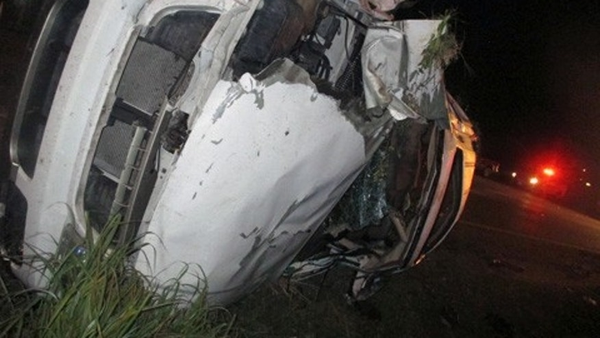 Sept. 24, 2015: In this photo provided by the Edna (Texas) Police Department, an SUV that flipped several times remains on the scene following a fatal crash and police chase. Officers tried to stop the SUV for a traffic violation but the vehicle sped away and police gave chase. (Edna Police Department via AP)