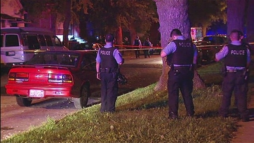 Sept. 27, 2015: Chicago police investigate a drive-by shooting on the city's South Side that killed two women and wounded three others, including one of the victims' 11-month-old son (Fox 32 Chicago)