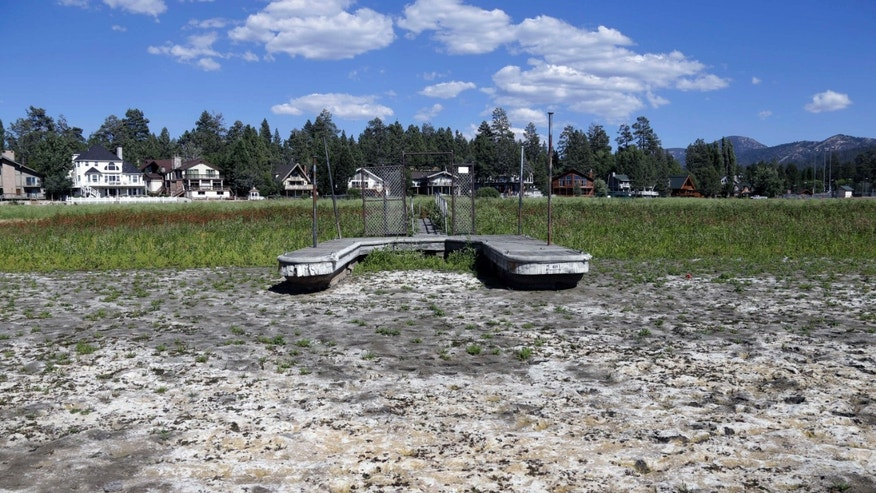 FILE - This Aug. 24, 2015, file photo, shows a boat dock by the lake bed where water has dried due to the drought at Big Bear Lake, Calif.