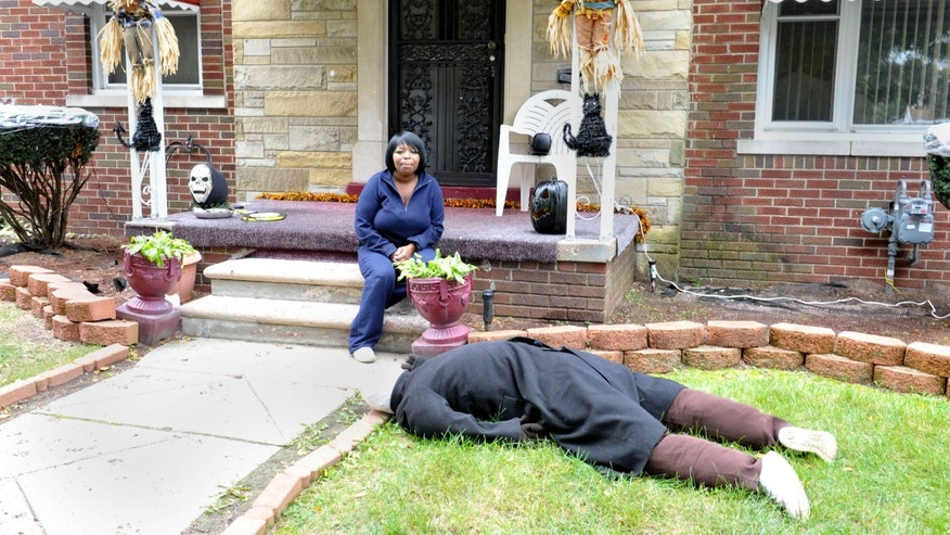 Oct. 9, 2015: Jeannine Haddon poses on the porch of her Halloween decorated home in Detroit.