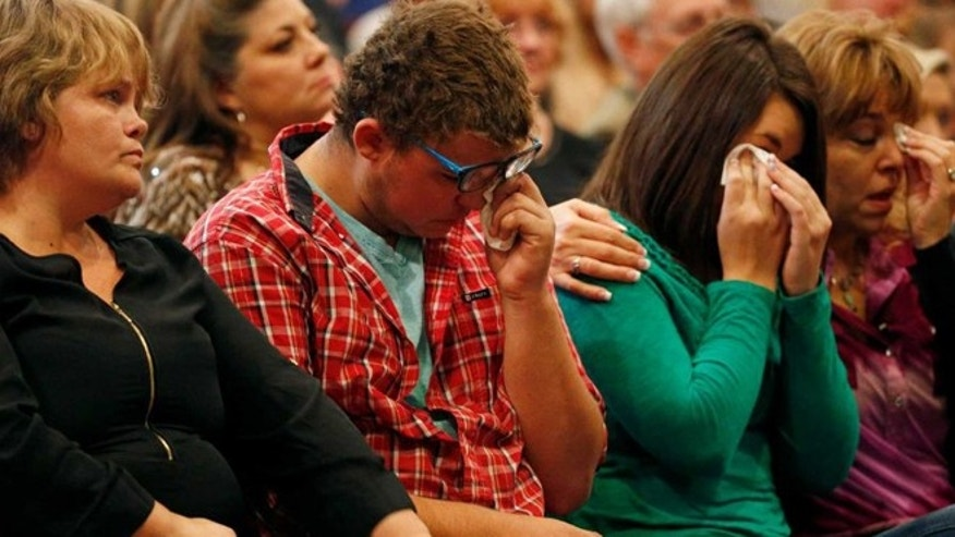 From left, Summer Smith, Mathew Downing, Lacey Scroggins and Lisa Scroggins attend a Roseburg, Ore., church service,  Sunday, Oct. 4, 2015. Downing and Lacey Scroggins are survivors of the shooting at Umpqua Community College.(AP)