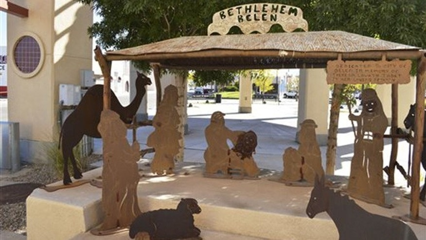Oct. 13, 2015: A Nativity scene in Belen, N.M., is displayerd next to City Hall, where it has been since 1992. The little town of Belen  Spanish for Bethlehem  is fighting to keep the all-year round Nativity scene on city property, despite objections from a Wisconsin-based organization who that wants it removed over church-state concerns.