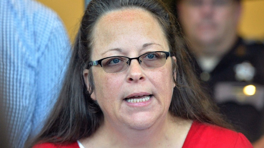 FILE - In this Sept. 14, 2015 file photo, Rowan County Clerk Kim Davis makes a statement to the media at the front door of the Rowan County Judicial Center in Morehead, Ky.
