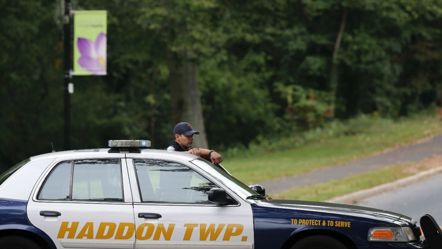Oct. 13, 2015: A police officer blocks a street near Cooper River park near where a 3-year-old boy who was reported missing was found dead three hours later several blocks from his home in Haddon Township, N.J.