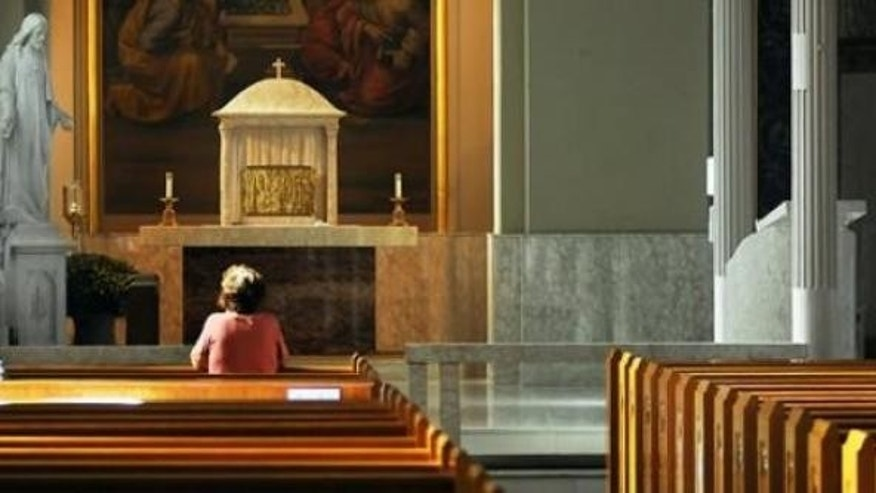 A survey shows nearly half of Americans worry about their religious rights. (Butch Comegys/The Times & Tribune via AP)