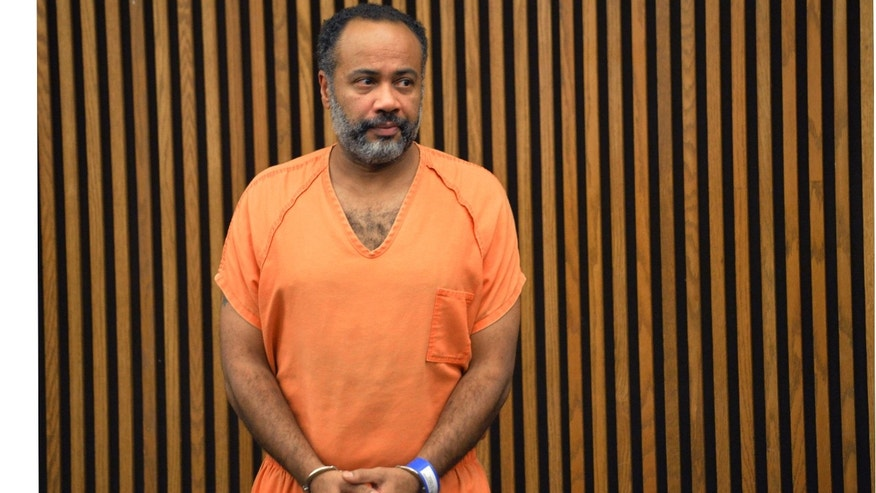Oct. 16, 2015 - Robert Rembert Jr. appears during his arraignment in Cuyahoga County Common Pleas Court in Cleveland. The Cleveland truck driver, 45, pleaded not guilty to multiple counts of aggravated murder in the slayings of 4 people.
