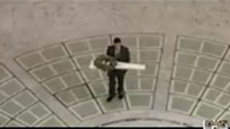 Oct. 15, 2015: This image shows an unidentified man carrying a package containing an unloaded rifle into Utah's state capitol building in Salt Lake City. (Utah Department of Public Safety)