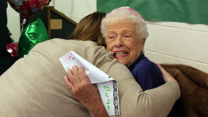 Oct. 15, 2015: Assistant Principal Meredith Quick hugs Evelyn Kiss of Fanwood, who has worked in the high school cafeteria since 1964, as they celebrates Kiss' 95th birthday with students, employees and faculty at J.P. Stevens High School in Edison, N.J.