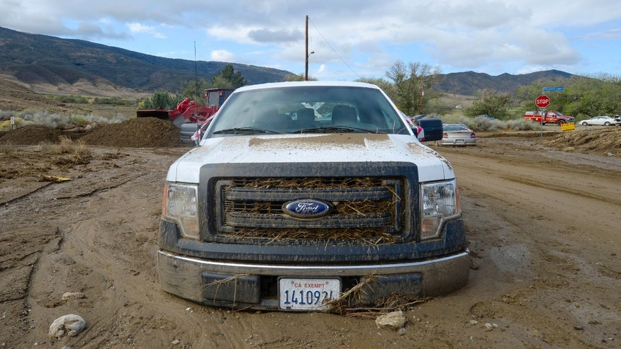 A truck sits trapped by mud in Leona Valley, Calif., on Friday. (AP Photo/Gus Ruelas)